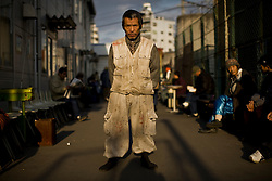 """Syunsuke Fujii, 64, an unemployed carpenter in Kamagasaki, Japan. Kamagasaki, Osaka, used to be a thriving day laborer's town, but today it is home to about 25,000 mainly elderly former day laborers, with an estimated 1,300 who are homeless. There are rarely any work for graying men in construction jobs, instead, alcoholism, poverty, street death, suicide, TB and most of all loneliness prevail here. Without family ties, these men live and die alone as social outcasts from the mainstream """"salary man"""" culture."""
