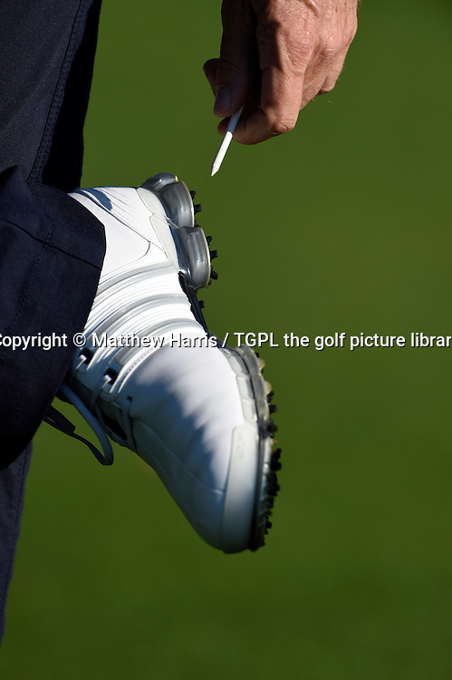 Bernhard LANGER (GER) cleans the sole of his golf shoe with a tee during first round US Masters 2014,Augusta National,Augusta, Georgia,USA.