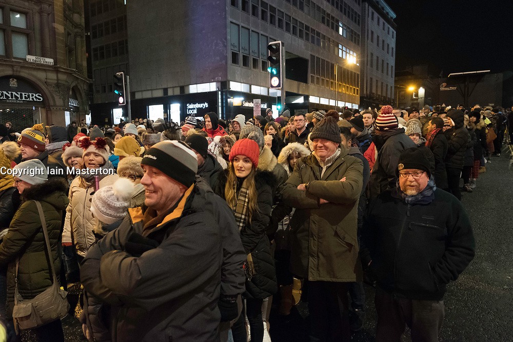 Public queue to enter Edinburgh Hogmanay street party in the city on New Year's Eve. Scotland, United Kingdom.