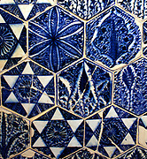 Tiles.  Panel of hexagonal tiles with vegetal and geometric decoration. Syria, about 1400-1430. Fritware, with underglaze painting in blue.  Doors. Pair of doors with geometric insets.  Egypt about 1270-1320. Wood, with carved ivory and ebony insets.  The presence of crosses on five of the ivory plaques suggests that these doors belonged to a Christian building, possibly a Coptic church.