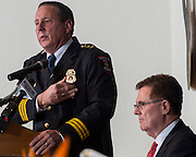 Houston ISD Chief of Police Robert Mock, left, comments after being sworn into office by superintendent Dr. Terry Grier, right, January 6, 2014, at the High School for Law Enforcement and Criminal Justice.