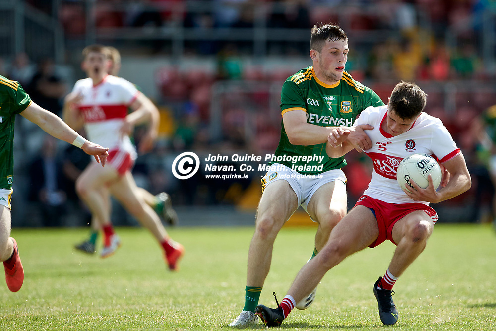 2021-7-10, 2020 All Ireland MFC Semi-Final at Pairc Esler, Newry.<br /> Meath v Derry<br /> Liam Kelly (Meath) and Mark Doherty (Derry)<br /> Photo: David Mullen / www.quirke.ie ©John Quirke Photography, Proudstown Road Navan. Co. Meath. 046-9079044 / 087-2579454.<br /> ISO: 400; Shutter: 1/1600; Aperture: 5;