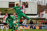 Watford forward Adalberto Peñaranda (17) and Woking defender Nathan Collier (2) go for the ball during the The FA Cup 3rd round match between Woking and Watford at the Kingfield Stadium, Woking, United Kingdom on 6 January 2019.