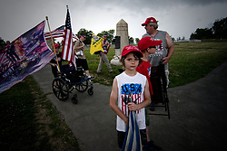 Trump supporters leave the Civil War battlegrounds in Gettysburg, Pennsylvania, ahead of a storm, on July 1st, 2017. Patriotic activist staged several free speech rallies on the 154th anniversary of the historic battle.