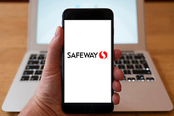 Using iPhone smartphone to display logo of Safeway chain of grocery stores