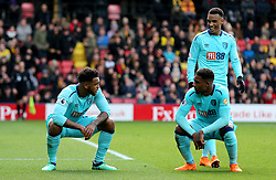 AFC Bournemouth's Joshua King (left) celebrates scoring his side's first goal of the game with team-mate AFC Bournemouth's Jordon Ibe (bottom right) during the Premier League match at Vicarage Road, London.