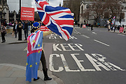 A day after Commons Speaker John Bercow announced his refusal to accept Prime Minster Theresa May's third Brexit Meaningful Vote, a Remainer protests outside the gates of parliament, on 19th March 2019, in London, England.