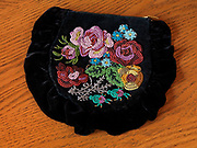 Athabascan beaded purse with floral design on black velvet.