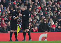 Football - 2016 / 2017 Premier League - Arsenal vs. Burnley<br /> <br /> Referee Jon Moss consults his linesman before sending off Granit Xhaka of Arsenal  at The Emirates.<br /> <br /> COLORSPORT/ANDREW COWIE