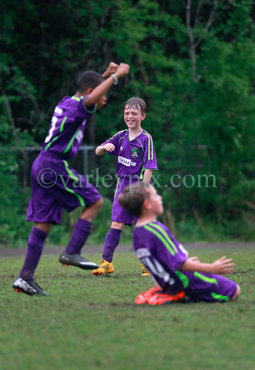 12 April 2015. Hammond, Louisiana.<br /> Champions! <br /> U9 New Orleans Jesters Elites, team purple defeat U10 PAC Piranhas 5-1 to win their division against U10 teams in the Strawberry Cup hosted by the South Tangipahoa Youth Soccer Association (STYSA).<br /> Photo; Charlie Varley/varleypix.com