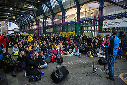 London, UK. 7 October, 2019. Animal rights activists from Extinction Rebellion occupy Smithfield meat market for an Animal Rebellion including a plant-based food market, on the first day of International Rebellion protests to demand a government declaration of a climate and ecological emergency, a commitment to halting biodiversity loss and net zero carbon emissions by 2025 and for the government to create and be led by the decisions of a Citizens' Assembly on climate and ecological justice.
