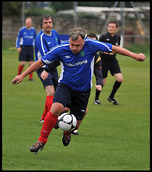 Shadow Chancellor Ed Balls playing football during the Labour Politicians v Reporter's Football match at the Labour Party Autumn Conference. Sunday, 22nd September 2013. Picture by Andrew Parsons / i-Images