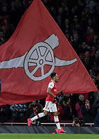Football - 2019 / 2020 Premier League - Arsenal vs. Everton<br /> <br /> Pierre-Emerick Aubameyang (Arsenal FC) runs in front of the giant Arsenal flag after scoring his teams third goal at The Emirates Stadium.<br /> <br /> COLORSPORT/DANIEL BEARHAM