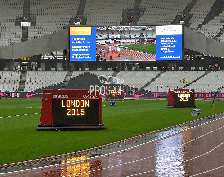 A very wet Olympic Stadium prepares for the Sainsbury's Anniversary Games at the Queen Elizabeth II Olympic Park, London, United Kingdom on 24 July 2015. Photo by Mark Davies.