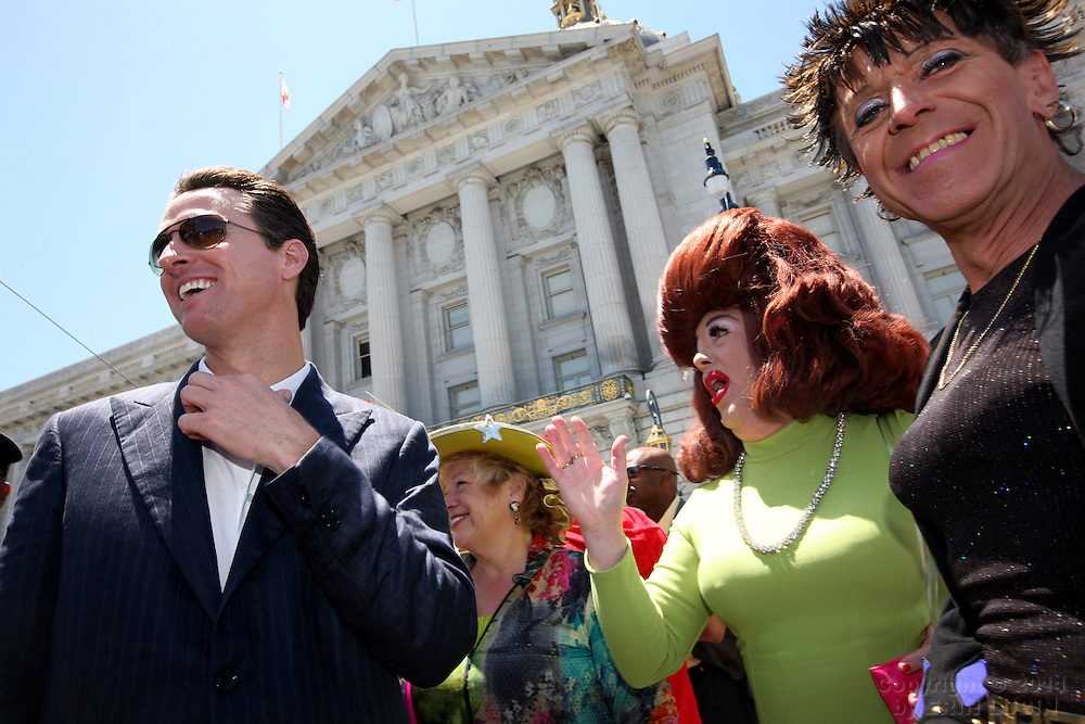 San Francisco Mayor, Gavin Newsom, left, visits with local entertainers, Mark Sargent, dressed as Ethel Merman, middle, and Anita Oneida, right, before taking the stage at the annual Gay Pride Parade in downtown San Francisco, Calif. Sunday, June 24, 2007...PHOTOGRAPHER: Erin Lubin/Bloomberg News.