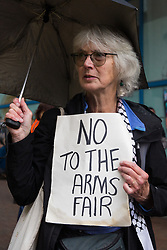 A Stop The Arms Fair activist protests outside ExCeL London on the first day of the DSEI 2021 arms fair on 14th September 2021 in London, United Kingdom. Activists from a range of different groups have been protesting outside the venue for one of the world's largest arms fairs for over a week.