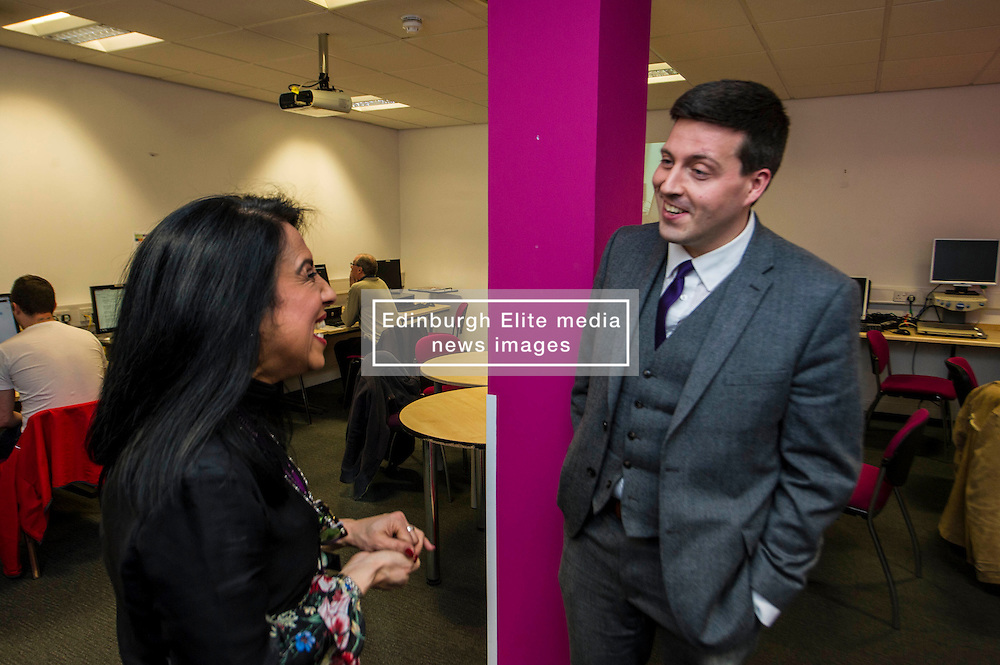 Pictured: Butal Hassan outlines her path to Remploy to Mr Hepburn<br /> <br /> Today, Minister for employability and training, Jamie Hepburn MSP visited Remploy in Edinburgh where he announced new employment services funding. Mr Hepburn gave details on cash which will develop new ways of supporting the Scottish Government's new devolved employment services. <br /> <br /> Ger Harley   EEm 21 December 2016