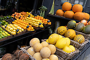 Local grocer 'Bora & Sons', a fruit and veg retailer, displays elons, pumpkins and other produce outside its high street business on Lordship Lane in East Dulwich, on 25th October 2021, in London, England.