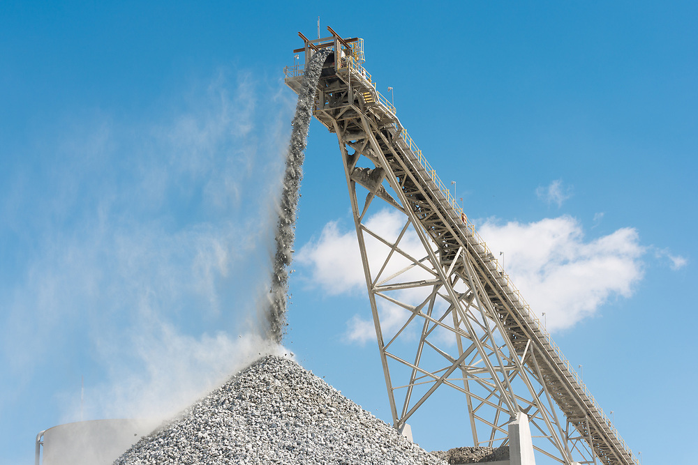Stockpile and conveyor belt at an open-pit copper mine in Latin America
