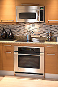 Kitchen Remodel with New Granite Countertops, Cabinets and Stainless Steel Appliances
