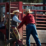 Cal Ruark welcomes Geral Eash to the arena at the Darby MT Elite Proffesionals Bull Riding Event July 7th 2017.  Photo by Josh Homer/Burning Ember Photography.  Photo credit must be given on all uses.