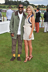 TINIE TEMPAH and MOLLIE KING at the 2012 Veuve Clicquot Gold Cup Final at Cowdray Park, Midhurst, West Sussex on 15th July 2012.