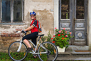 Cyclist in the village of Petrina along the Kupa River, Slovenia