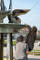 Homeless man looking for change in a turned off Fountain stratford upon avon uk photo by Mark Anton Smith