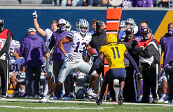 Oct 31, 2020; Morgantown, West Virginia, USA; Kansas State Wildcats wide receiver Chabastin Taylor (13) makes a catch and runs during the first quarter against the West Virginia Mountaineers at Mountaineer Field at Milan Puskar Stadium. Mandatory Credit: Ben Queen-USA TODAY Sports