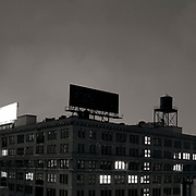 Empty black billboard advertising nothing atop a building in DUMBO brooklyn