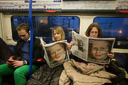 London 8/4/2013 - Londoners on an underground train read of the death of ex-British Prime Minister, Baroness Margaret Thatcher whose death was announced on April 8th, 2013 in London. Thatcher (known to Britons as Maggie) served as leader of the Conservative party then Prime Minister of Britain from 1979 to 1990 and passed away peracefully from a stroke at age 87.