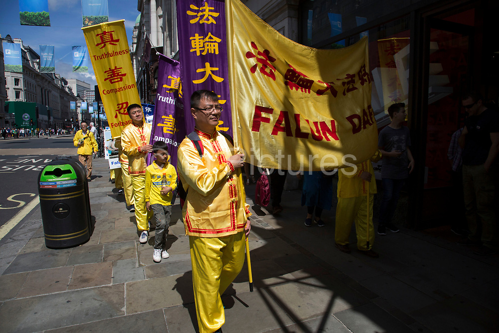 Members of Falun Gong or Falun Dafa protest concerning the alleged improsonment / torture and organ harvesting of fellow members in mainland China on 16th July 2016 in London, United Kingdom. They claim that tens of thousands of fellow practitioners are being held unlawfully in Chinese prisons. (photo by Mike Kemp/In Pictures via Getty Images)