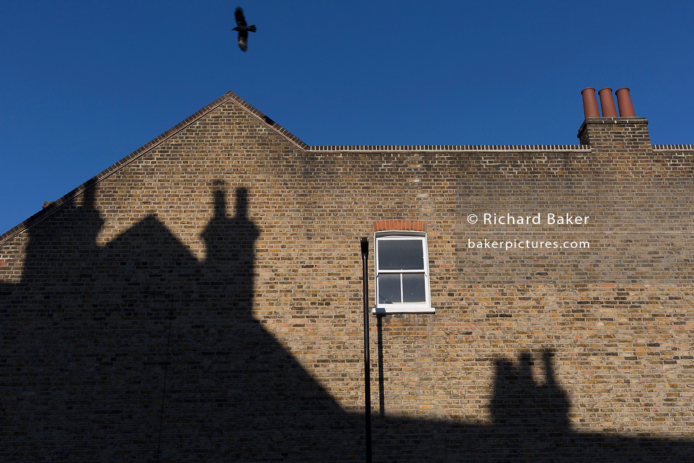 Victorian-era chimney pots and blue skies above south London in Herne Hill, on 14th February 2019, in London, England.
