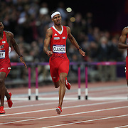 Michael Tinsley, USA, (left) winning the Silver Medal, Javier Culson, Puerto Rico, winning the Bronze Medal (centre) and Angelo Taylor, USA, at the finish of the Men's 400m Hurdles Final at the Olympic Stadium, Olympic Park, during the London 2012 Olympic games. London, UK. 6th August 2012. Photo Tim Clayton