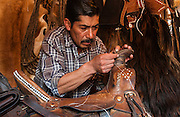 Pacifico Herminio Veloz-Heredia<br /> 'Talabartero' or Saddlemaker<br /> He is one of the most well known saddlemakers of the region who cures his own bull hide and makes the 'tree' of the saddle from specially selected wood. He is also a lasso champion and rodeo expert <br /> Pintag near Antisana Volcano<br /> Andes<br /> ECUADOR South America