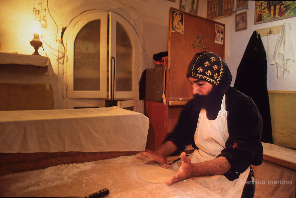 """St Antony coptic monastery, in the night the monks prepare the bread. The monastey, nestled amount the mountains near the Red sea, is the oldest and biggest of the Coptics monasteries, founded in 4th century from disciples of St Antony. Here, in this desert, is born the Christian experience of the monks and monasteries. Coptics, Greek Orthodox, Syrians, only few components of the fragmented galaxy of the """"living stones"""" as often are defined the oriental christian churches, are the protagonists of a frequently forgotten world that currently menaces to die in the same places in which Christianity born. Rituals and stories similar to legends lost in time survive intact and in these places regain the strenght of a living reality."""