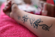 An arm with a Henna design