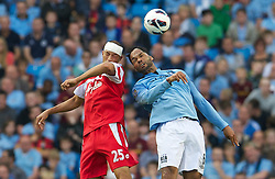 01.09.2012, Etihad Stadion, Manchester, ENG, Premier League, Manchester City vs Queens Park Rangers, 2. Runde, im Bild Manchester City's Joleon Lescott in action against Queens Park Rangers' Bobby Zamora during the English Premier League 2nd round match between Manchester City and Queens Park Rangers at the Etihad Stadium, Manchester, Great Britain on 2012/09/01. EXPA Pictures © 2012, PhotoCredit: EXPA/ Propagandaphoto/ David Rawcliff..***** ATTENTION - OUT OF ENG, GBR, UK *****