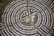 Aerial photograph of tract housing in Sun City, Arizona. Sun City is one of the nations first planned retirement communities for active seniors. The community center is at the center of a hub of circular streets with white-roofed houses..