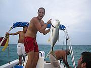 Caye Caulker, Belize. European tourist fishing