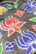 A Kolam decoration outside a house in Pondicherry, India.<br /> Also known as Rangoli, Kolam is an art form from India in which patterns are created on the floor in living rooms or courtyards using materials such as colored rice, dry flour, colored sand or flower petals. <br /> Pondicherry now Puducherry is a Union Territory of India and was a French territory until 1954 legally on 16 August 1962. The French Quarter of the town retains a strong French influence in terms of architecture and culture.
