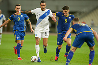 ATHENS, GREECE - OCTOBER 14: Dimitris Kourbelisof Greece and Herolind Shalaof Kosovo during the UEFA Nations League group stage match between Greece and Kosovo at OACA Spyros Louis on October 14, 2020 in Athens, Greece. (Photo by MB Media)