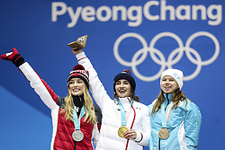 PYEONGCHANG, Feb. 12, 2018  Champion Perrine Laffont from France(C), second-placed Justine Dufour-Lapointe from Canada (L) and third-placed Yulia Galysheva from Kazakhstan pose for photos during medal ceremony for ladies' moguls event of freestyle skiing at 2018 PyeongChang Winter Olympic Games at the Medal Plaza in PyeongChang, South Korea, on Feb. 12, 2018. (Credit Image: © Wu Zhuang/Xinhua via ZUMA Wire)