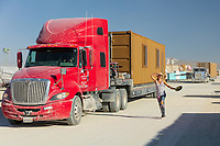 My friend Vanessa and some big trucks.