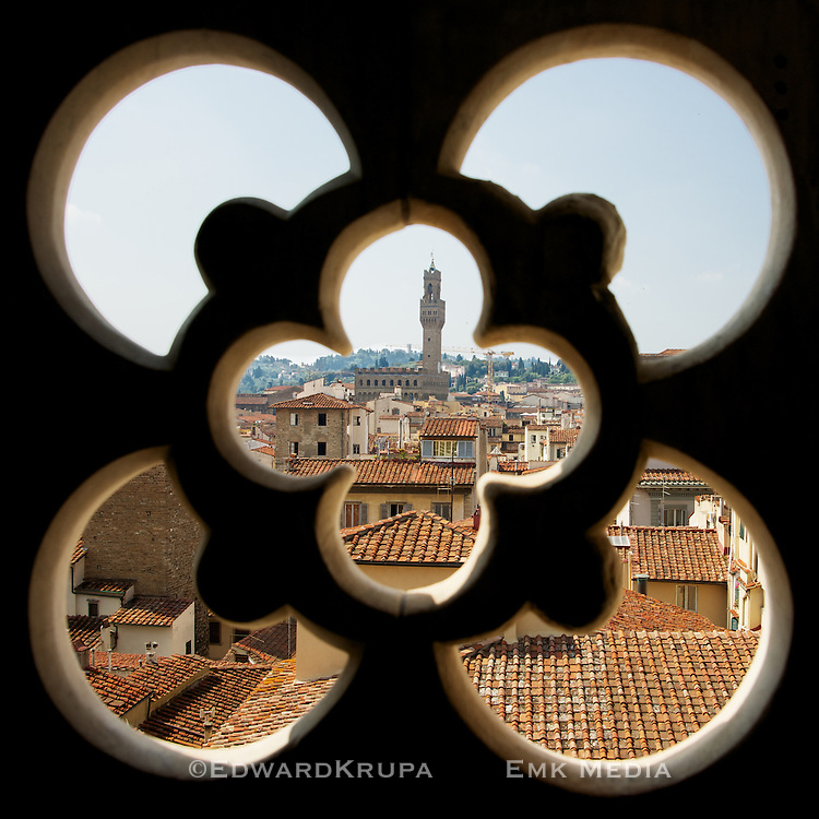View of Florence from Giotto's Campanile, part of the complex of buildings that make up Florence Cathedral on the Piazza del Duomo in Florence, Italy. You can see  Palazzo Vecchio's imposing 100m tower in the center.