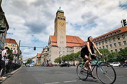 View along Karl Marx Strasse towards Rathaus or town hall in Neukolln district in Berlin Germany