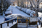 Winter street scene in the snow in Moor Green on 25th January 2021 in Birmingham, United Kingdom. Deep snow arrived in the Midlands giving some light relief and fun during the current lockdown for people who simply enjoyed the weather.