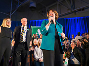 01 FEBRUARY 2020 - DES MOINES, IOWA: US Senator AMY KLOBUCHAR (D-MN) on stage with her daughter ABIGAIL BESSLER and husband JOHN BESSLER during a campaign event in Des Moines. Sen. Klobuchar campaigned to support her candidacy for the US Presidency Saturday in Iowa. She is trying to capitalize on her recent uptick in national polls. Iowa holds the first selection event of the presidential election cycle. The Iowa Caucuses are Feb. 3, 2020.             PHOTO BY JACK KURTZ