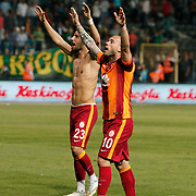 Galatasaray's Wesley Sneijder (R) and Yasin Oztekin (L) celebrate victory during their Turkish Super League soccer match Akhisar Belediye Genclik Spor between Galatasaray at the 19 Mayis Stadium in Manisa Turkey on Monday, 04 May 2015. Photo by Kurtulus YILMAZ/TURKPIX
