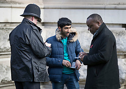 © Licensed to London News Pictures. 12/11/2017. London, UK. Police question a man during a security operation near Horse Guards Road during the Remembrance Sunday Ceremony at the Cenotaph in Whitehall. Photo credit: Peter Macdiarmid/LNP